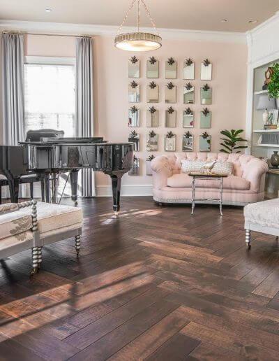 A parlor room area featuring Galloway black walnut, full scrape hardwood in a herringbone pattern from Barnum Floors.
