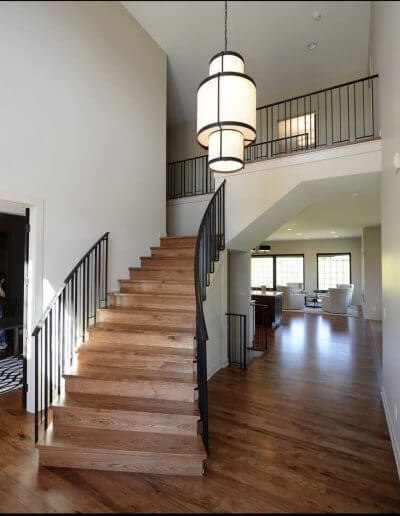 A staircase made of hickory hardwood with black railings.