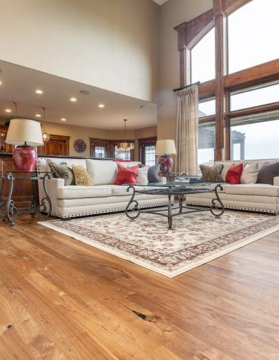 Beautiful hardwood featured in a open-concept kitchen and living room with wooden cabinetry and rich-colored trim.