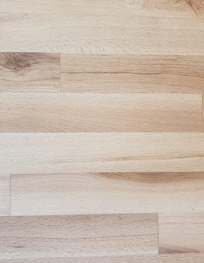 A close-up picture of natural red oak hardwood.