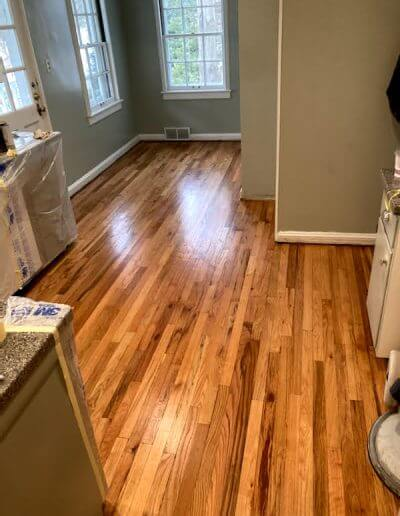 A picture of a red oak flooring in a kitchen after it's been refinished by Barnum Floors.
