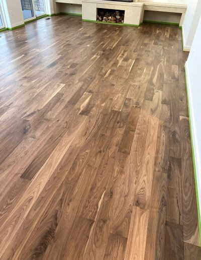 Refinished walnut hardwood flooring with a mixture of light and dark wood colors and a variety of grains.
