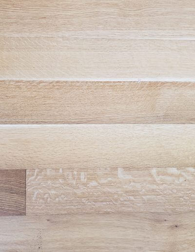 A close-up picture of unfinished white oak flooring.