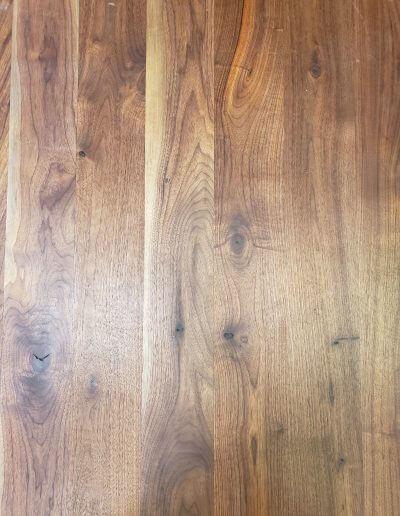 A close-up of natural walnut hardwood flooring.