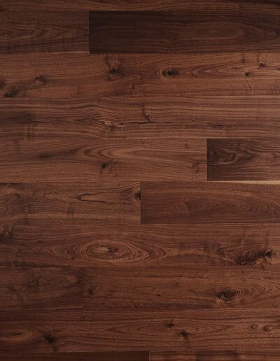 A close-up picture of dark stained walnut hardwood.
