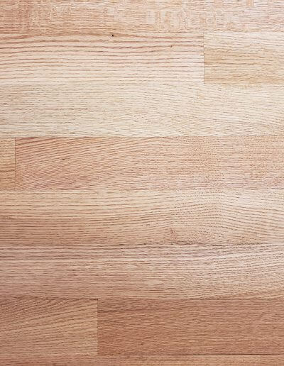 A close-up picture of unfinished red oak hardwood.